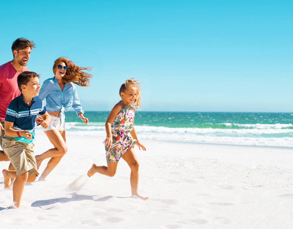 Happy family running on beach